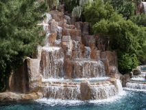 Waterfalls in a landscaped garden. Semi side full view of a man-made waterfalls in a landscaped garden royalty free stock images