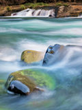 Waterfalls and mossy logs and rocks Royalty Free Stock Image