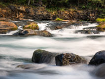 Waterfalls and mossy logs and rocks Stock Photos