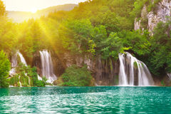 Waterfalls in national park in sun rays. Plitvice, Croatia Royalty Free Stock Images