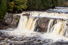 Waterfalls in new brunswick. Waterfall rushing in a rural area of new brunswick royalty free stock photography