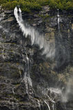 Waterfalls in a Norwegian fjord. Waterfall in a fjord in the Norwegian summer Stock Photography