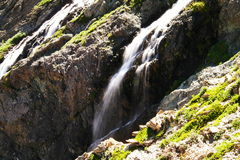 Waterfalls off the swift current trail. Royalty Free Stock Photo