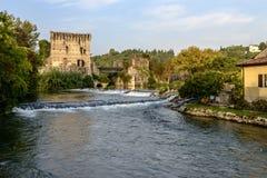 Waterfalls and old bridge and Mincio river, Valeggio, Italy Stock Images