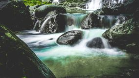 Waterfalls over Black Stones royalty free stock images