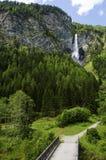 Waterfalls over the bridgein austria Stock Image