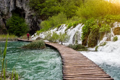 Waterfalls and pathway in the Plitvice National Park, Croatia. Waterfalls and pathway in the sunshine in the Plitvice National Park, Croatia Royalty Free Stock Images