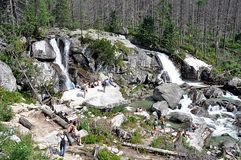 Waterfalls and people, mountains High Tatras, Slovakia, Europe Royalty Free Stock Images