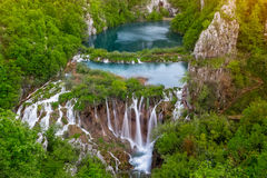 Waterfalls in the Plitvice National Park, Croatia. Breathtaking aerial view of giant waterfalls with crystal clear water in the Plitvice National Park, Croatia Royalty Free Stock Image