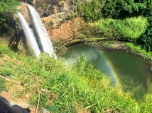 Waterfalls with rainbow at Wailua Falls on Kauai Hawaii Stock Image