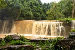 Waterfalls during the rainy season The red soil. stock image