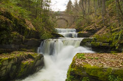 Waterfalls in Rhodopi mountain, Bulgaria. Waterfalls in early spring somewhere in the deep forest of Rhodopi mountain, Bulgaria Royalty Free Stock Images