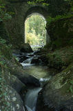 Waterfalls in River in France. With Archway Stock Photo