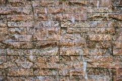 Waterfalls rock wall in garden Stock Photo