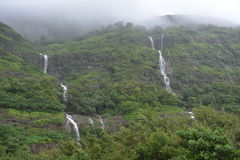 Waterfalls. Scenic gateway along Tamhini Ghat Pune .Clouds ,Rains and Greenery Royalty Free Stock Photos