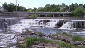 Waterfalls in a small town stock video footage