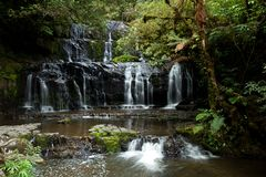 Waterfalls in south island in New Zealand. Purakaunui waterfalls in southern island in New Zealand by a nice summer day royalty free stock images