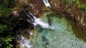 The waterfalls, the stream and the clear and clear water of Val Vertova. A naturalistic oasis in the province of Bergamo, Italy stock footage