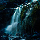 Waterfalls Surrounded With Rocks Stock Image