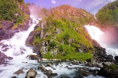 Waterfalls surrounded by wild forest royalty free stock photography