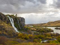 Waterfalls in Idaho. A waterfalls tumbles from a rocky cliff in the Thousand Springs area of western Idaho stock images