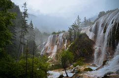 Waterfalls in Yellow Rocks Under White Foggy Sky Stock Photography