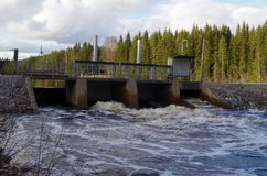 A dam on a lake. The waterflow is under control with this dam on a lake Royalty Free Stock Photos