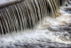 Waterflow waterfall  on a small creek Royalty Free Stock Images