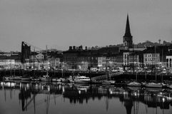 Panoramic view of a cityscape at night with illumination in Waterford, Ireland. Black and white Royalty Free Stock Images