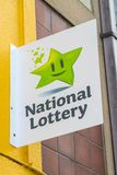 Irish National Lottery. Waterford, Republic of Ireland - August 14th 2018: A sign advertising the Irish National Lottery above the entrance to a shop in the city royalty free stock image