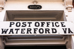 Waterford, Virginia, Post Office Sign. Hand-painted sign in black block letters over doorway of Post Office in historic Waterford, Virginia Stock Photo