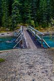 Waterfowl Lakes, Banff National Park, Alberta, Canada. A bridge over mistaya creek leads to the next hiking trail Stock Image