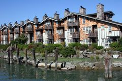Waterfrong Living. A row of condos on the waterfront royalty free stock photo