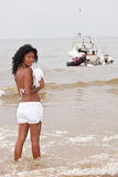 At the waterfront. Beautiful brazilian girl standing in the ocean water Royalty Free Stock Image
