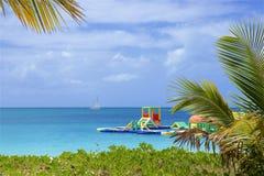 Waterfront in Antigua, Caribbean. Beautiful turquoise waters of Antigua, Darkwood beach, Caribbean royalty free stock images