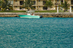 Waterfront apartments with boat, Bahamas Stock Image
