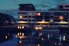 Waterfront apartments at night Royalty Free Stock Photography
