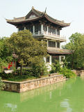 Waterfront Asian Pagoda. Asian pagoda in a waterfront garden near Suzhou, China. I love the contrast between the powerful architecture against the green from the royalty free stock photography