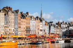 Waterfront in Honfleur town, France. Waterfront with beautiful old buildings in Honfleur, famous french town in Normandy royalty free stock photo