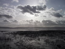 Waterfront , bonny Dundee- love nature. Beautiful cloudy day, waterfront Invergowrie bay, Scotland. Tide, clouds, with hills in the distance Stock Image