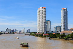 Waterfront Buildings in Bangkok, Thailand. The riverside skyscraper buildings against the skyline in Bangkok, Thailand Stock Photo