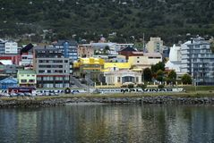 Waterfront in Ushuaia Harbor, Argentina. Waterfront buildings looking into the town from Ushuaia Harbor, approaching from the Beagle Channel, Ushuaia, Argentina Stock Photography