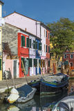 Waterfront canal on the island Burano Royalty Free Stock Image