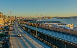 Waterfront in the city of Seattle. Waterfront of Seattle, Washington, USA - October 4, 2015: Sunset on the highway that crosses the waterfront in the city of stock photography