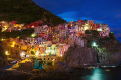 Waterfront cliff town of Manarola at night. Cinque Terre, Liguria, Italy Royalty Free Stock Photos