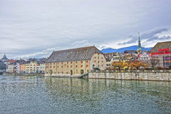Waterfront and Clock Tower with Landhaus in Solothurn in Switzerland. Waterfront and Clock Tower with Landhaus in Solothurn. Solothurn is the capital of stock photo