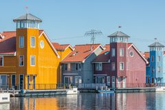 Waterfront with colorful wooden houses in Dutch Reitdiep harbor, Groningen stock image