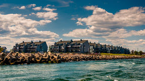 Waterfront condos and a jetty in Point Pleasant Beach, New Jerse Royalty Free Stock Photos