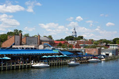 Waterfront Downtown Annapolis Maryland. ANNAPOLIS, MARYLAND - JULY 11, 2016: View of downtown Annapolis, Maryland, USA, waterfront with the dome of the Maryland Royalty Free Stock Photography