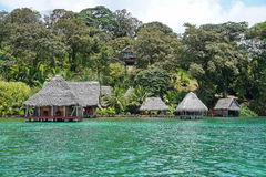 Waterfront ecolodge with thatched hut overwater Royalty Free Stock Image